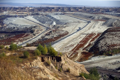 (AP Photo/Darko Vojinovic). In this photo taken Wednesday, Oct. 3, 2018, mining machines work in the open cast mine near Kostolac, Serbia. The Kostolac power plant complex in eastern Serbia is currently being expanded with a $715 million loan from a Ch...