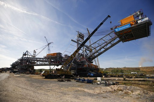 (AP Photo/Darko Vojinovic). In this photo taken Wednesday, Oct. 3, 2018, a new lignite excavator stands in the open cast mine near Kostolac, Serbia. The Kostolac power plant complex in eastern Serbia is currently being expanded with a $715 million loan...