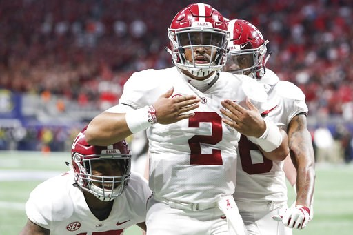 (AJ ReynoldsAthens Banner-Herald via AP). Alabama quarterback Jalen Hurts (2) celebrates after scoring the during the fourth quarter against Georgia during an NCAA college football game for the Southeastern Conference championship Saturday, Dec. 1, 201...