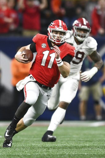 (AJ Reynolds/Athens Banner-Herald via AP). Georgia quarterback Jake Fromm (11) runs with the ball during an NCAA college football game against Alabama for the Southeastern Conference championship Saturday, Dec. 1, 2018, in Atlanta.