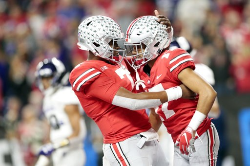 (AP Photo/AJ Mast). Ohio State wide receiver Chris Olave, right, is congratulated by quarterback Dwayne Haskins (7) after catching a touchdown pass during the second half of the Big Ten championship NCAA college football game against Northwestern, Satu...