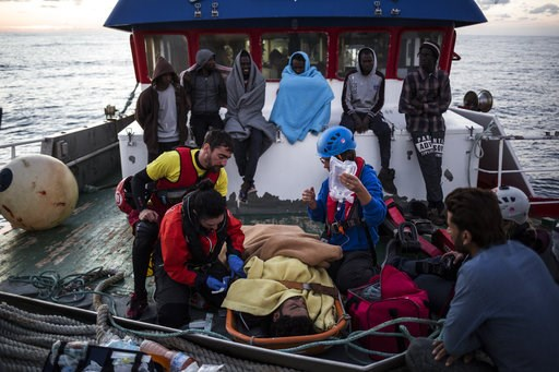 (AP Photo/Javier Fergo). In this Friday, Nov. 30, 2018, photo, a migrant is prepared to be evacuated for medical reasons by helicopter from the Nuestra Madre de Loreto Spanish fishing vessel carrying 12 migrants rescued off the coast of Lybia.
