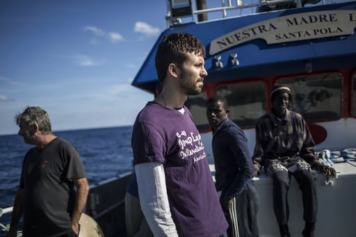 (AP Photo/Javier Fergo). Pascual Dura, the capitain the Nuestra Madre de Loreto Spanish fishing vessel carrying 12 migrants rescued off the coast of Lybia, stands on the deck on Friday, Nov. 30, 2018. Meanwhile, Spanish officials say they have rescued ...