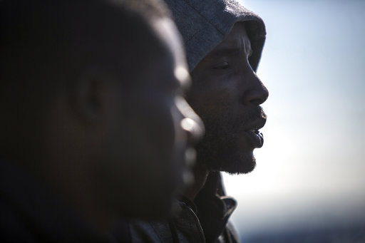 (AP Photo/Javier Fergo). Migrants looks out from the Nuestra Madre de Loreto Spanish fishing vessel carrying 12 migrants rescued off the coast of Lybia on Friday, Nov. 30, 2018. Meanwhile, Spanish officials say they have rescued about 650 migrants from...