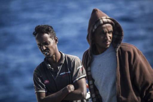 (AP Photo/Javier Fergo). Migrants stand on the deck of the Nuestra Madre de Loreto Spanish fishing vessel carrying 12 migrants rescued off the coast of Lybia on Friday, Nov. 30, 2018. Meanwhile, Spanish officials say they have rescued about 650 migrant...
