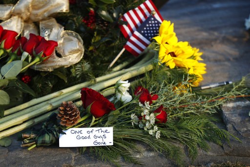 """(AP Photo/Robert F. Bukaty). Flowers and a note saying former President George H. W. Bush was """"one of the good guys,"""" are seen at a makeshift memorial across from Walker's Point, the Bush's summer home, Saturday, Dec. 1, 2018, in Kennebunkport, Maine. ..."""