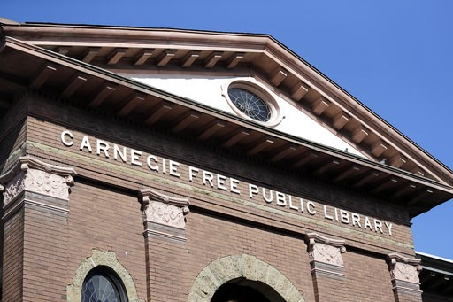 (AP Photo/Elaine Thompson). In this photo taken Wednesday, Oct. 10, 2018, the Carnegie name remains on what was the first major branch of the Seattle public library system, built with funds from philanthropist Andrew Carnegie, in Seattle. In service un...