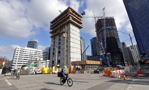 (AP Photo/Elaine Thompson). In this photo taken Wednesday, Oct. 10, 2018, construction goes on at the site of a new Amazon building, where space will be provided for a Mary's Place Family Shelter, in downtown Seattle. Amazon.com boss Jeff Bezos' plan t...