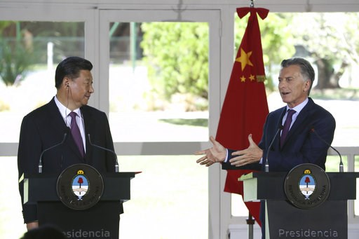 (AP Photo/Martin Mejia). China's President Xi Jinping, left, listens to Argentina's President Mauricio Macri during a joint press conference at presidential residence in Olivos, a northern suburb of Buenos Aires, Argentina, Sunday, Dec. 2, 2018.