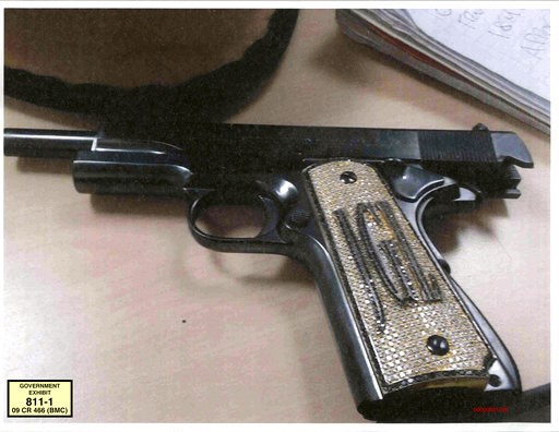(U.S. Attorney's Office via AP, File). FILE - In this undated file photo provided by the U.S. Attorney's Office for the Southern District of New York, a diamond-encrusted pistol that a government witness said belonged to infamous Mexican drug lord Joaq...