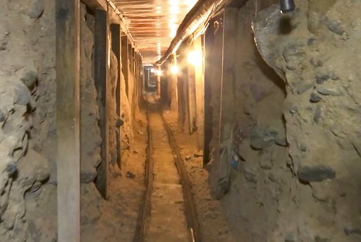 (Mexico's Attorney General's Office via AP). FILE - In this frame grab taken from a Monday, Dec. 12, 2016 video provided by the Mexican Attorney General's Office, or PGR, shows one of two tunnels found in an area of warehouses in the border city of Tij...