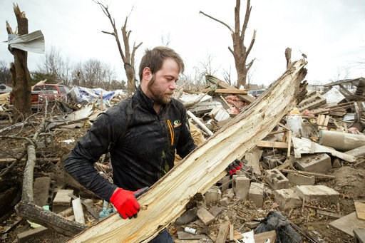 (Ted Schurter/The State Journal-Register via AP). Steven Tirpak cleans debris from the remains of his two-story home in Taylorville, Ill., Sunday, Dec. 2, 2018. Tirpak and his infant were not home when the storm struck. The National Weather Service say...