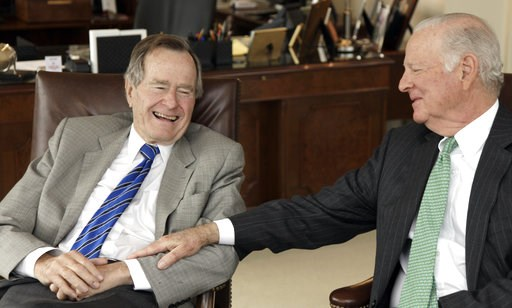 (AP Photo/David J. Phillip). FILE - In this Jan. 18, 2011 file photo, former President George H.W. Bush, left, and former Secretary of State James A. Baker III share a moment as they talk about the Gulf War and liberation of Kuwait, during an interview...