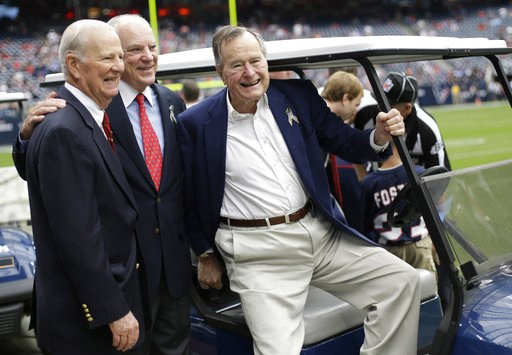 (AP Photo/Eric Gay). FILE - In this Nov. 4, 2012 file photo, former President George H. W. Bush, right, former Secretary of State James Baker, left, and Houston Texans owner Bob McNair pose together before an NFL football game against the Buffalo Bills...