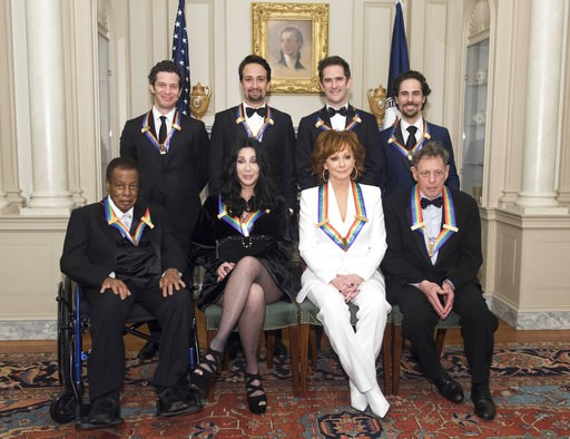 "(AP Photo/Kevin Wolf). 2018 Kennedy Center Honorees, front row form left, Wayne Shorter, Cher, Reba McEntire, Philip Glass, back row from left, the co-creators of ""Hamilton,"" Thomas Kail, Lin-Manuel Miranda, Andy Blankenbuehler, Alex Lacamoire pose for..."