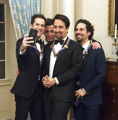 "(AP Photo/Kevin Wolf). 2018 Kennedy Center Honorees the co-creators of ""Hamilton,"" from left, Andy Blankenbuehler, Thomas Kail, Lin-Manuel Miranda, and Alex Lacamoire pose for a selfie following the Kennedy Center Honors State Department Dinner on Satu..."
