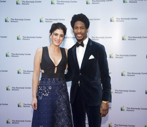 (AP Photo/Kevin Wolf). Pianist Jon Batiste and Suleika Jaouad arrive at the State Department for the Kennedy Center Honors State Department Dinner on Saturday, Dec. 1, 2018, in Washington.