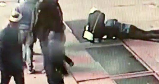 (NYPD via AP). In this Nov. 30, 2018 image taken from surveillance video provided by the New York City Police Department, a man tries to see the engagement ring that he dropped down a utility grate on New York's Times Square. The New York City Police D...