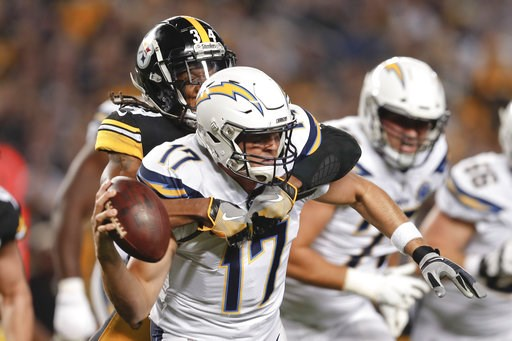 (AP Photo/Don Wright). Pittsburgh Steelers strong safety Terrell Edmunds (34), left, sacks Los Angeles Chargers quarterback Philip Rivers (17) in the first half of an NFL football game, Sunday, Dec. 2, 2018, in Pittsburgh.