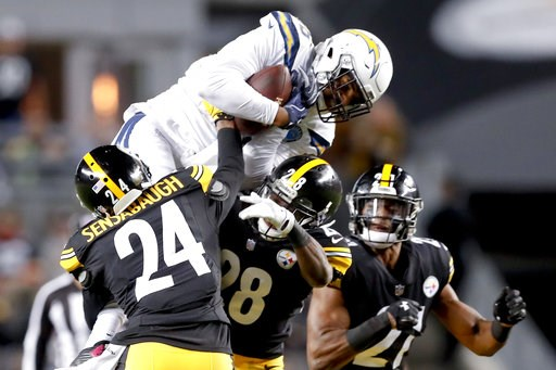(AP Photo/Don Wright). Los Angeles Chargers wide receiver Tyrell Williams (16) makes a catch over Pittsburgh Steelers cornerback Coty Sensabaugh (24) in the first half of an NFL football game, Sunday, Dec. 2, 2018, in Pittsburgh.