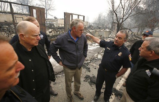 (AP Photo/Rich Pedroncelli, File). FILE - In a Nov. 14, 2018 file photo, Scott Upton, right, the chief of the Northern Region for the California Department of Forestry and Fire Protection briefs California Gov. Jerry Brown, second from left, Federal Em...