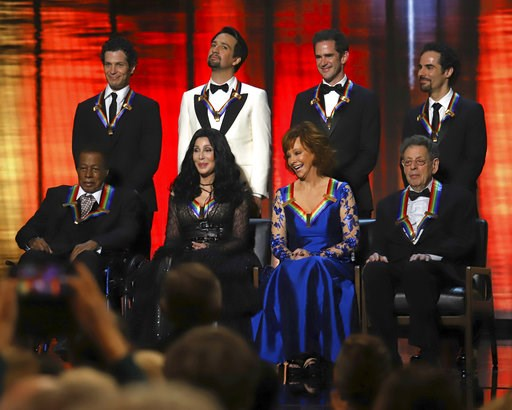 "(Photo by Greg Allen/Invision/AP). 2018 Kennedy Center honorees, front row from left, Wayne Shorter, Cher, Reba McEntire and Philip Glass; while back row from left, the co-creators of ""Hamilton,"" Thomas Kail, Lin-Manuel Miranda, Andy Blankenbuehler and..."