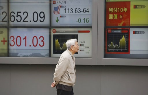 (AP Photo/Koji Sasahara). A man walks by an electronic stock board of a securities firm in Tokyo, Monday, Dec. 3, 2018. Shares are advancing in Asia following the meeting between Presidents Donald Trump and Xi Jinping, who agreed moderate tensions over...