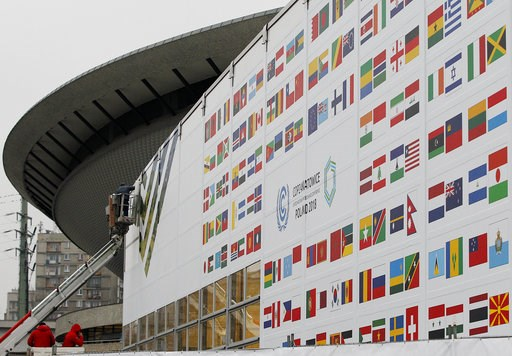 (AP Photo/Czarek Sokolowski). In this Nov. 20, 2018 photo workers decorate the venue of the global climate summit that will be held at the site of the closed 'Katowice' coal mine in the city of Katowice, Poland. The COP 24 UN Climate Change Conference ...