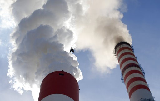 (AP Photo/Darko Vojinovic). In this photo taken Wednesday, Oct. 3, 2018, a bird flies past as smoke emits from the chimneys of Serbia's main coal-fired power station near Kostolac, Serbia. The COP 24 UN Climate Change Conference is taking place in Kato...
