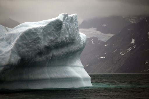 (AP Photo/Brennan Linsley, File). FILE- In this July 26, 2011 photo, a melting iceberg floats along a fjord leading away from the edge of the Greenland ice sheet near Nuuk, Greenland. The COP 24 UN Climate Change Conference is taking place in Katowice,...