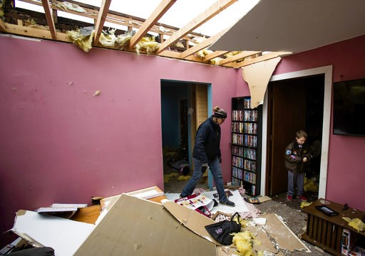 (Ted Schurter/The State Journal-Register via AP). Tammy Bowers and her son David gather a few items from the interior of their tornado-damaged home in Taylorville Ill., Sunday, Dec. 2, 2018. The National Weather Service says multiple tornadoes touched ...