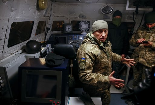 (Gleb Garanich/Pool Photo via AP). Ukrainian servicemen are seen aboard a naval ship in the Azov Sea port in Mariupol, Ukraine, Sunday, Dec. 2, 2018.  Ukraine's leader called on Germany and its allies to boost their naval presence in the Black Sea to d...