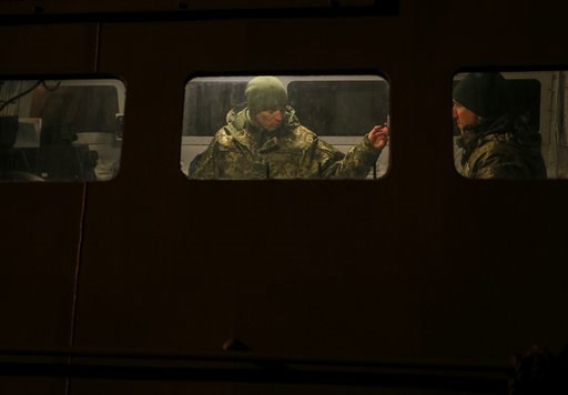 (Gleb Garanich/Pool Photo via AP). Ukrainian servicemen are seen at a naval ship in the Azov Sea port of Mariupol, Ukraine, Sunday, Dec. 2, 2018. Ukraine's leader called on Germany and its allies to boost their naval presence in the Black Sea to deter ...