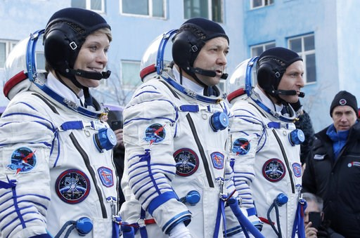 (AP Photo/Dmitri Lovetsky, Pool). U.S. astronaut Anne McClain, left, Russian cosmonaut ?leg Kononenko?, centre, and CSA astronaut David Saint Jacques, members of the main crew of the expedition to the International Space Station (ISS), report to member...