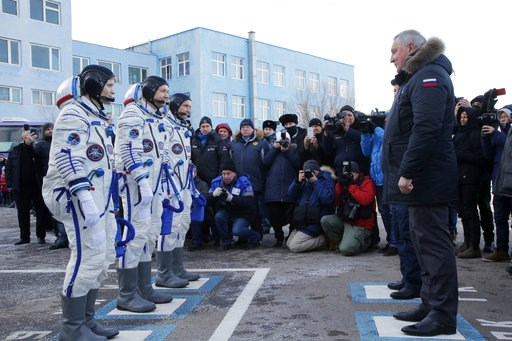 (AP Photo/Dmitri Lovetsky, Pool). U.S. astronaut Anne McClain, left, Russian cosmonaut ?leg Kononenko?, centre, and CSA astronaut David Saint Jacques, members of the main crew of the expedition to the International Space Station (ISS), report to head o...