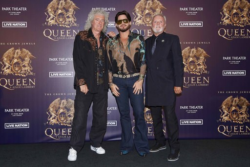 "(Photo by Al Powers/Powers Imagery/Invision/AP, File). FILE - In this Aug. 28, 2018, file photo, Brian May, from left, Adam Lambert, and Roger Taylor of Queen + Adam Lambert pose for a photo at the ""The Crown Jewels"" residency press conference at the M..."