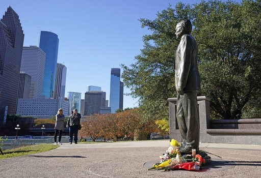 (AP Photo/David J. Phillip). Deitz Kracker, left, and Marg Frazier visit a statue of former President George H.W. Bush in downtown Houston, Sunday, Dec. 2, 2018. Bush is returning to Washington as a revered political statesman, hailed by leaders across...