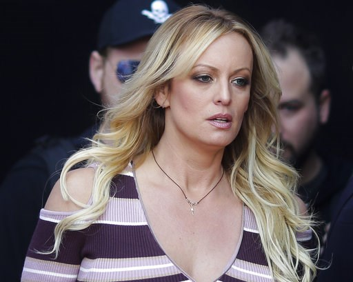 "(AP Photo/Markus Schreiber, File). FILE - In this Oct. 11, 2018, file photo, adult film actress Stormy Daniels arrives for the opening of the adult entertainment fair ""Venus,"" in Berlin. Attorneys for President Trump want a Los Angeles judge to award $..."