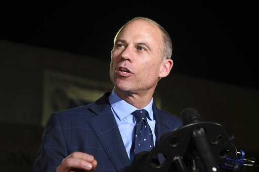 (AP Photo/Michael Owen Baker, File). FILE- In this Nov. 14, 2018, file photo Michael Avenatti speaks to the media outside the Los Angeles Police Department Pacific Division after posting bail for a felony domestic violence charge. Attorneys for Preside...