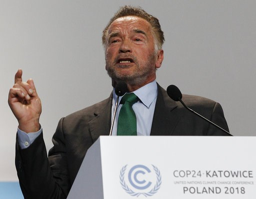 (AP Photo/Czarek Sokolowski). Actor Arnold Schwarzenegger delivers a speech during the opening of COP24 UN Climate Change Conference 2018 in Katowice, Poland, Monday, Dec. 3, 2018.