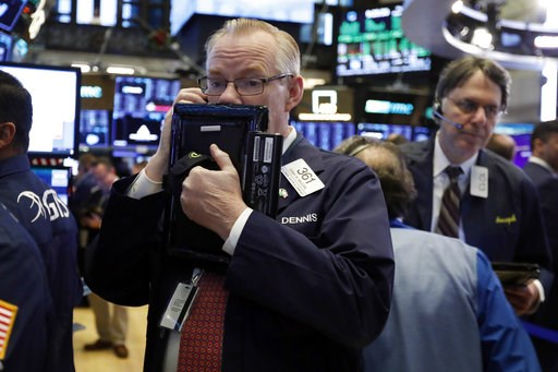 (AP Photo/Richard Drew, File). FILE- In this Thursday, Nov. 29, 2018, file photo trader Dennis Maguire, left, works on the floor of the New York Stock Exchange. The U.S. stock market opens at 9:30 a.m. EST on Monday, Dec. 3.