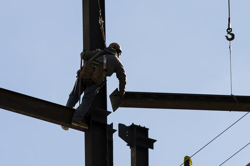 (AP Photo/Matt Rourke, File). FILE- In this Nov. 29, 2018, file photo an Ironworker helps to construct a building in Philadelphia. On Monday, Dec. 3, the Commerce Department reports on U.S. construction spending in October.