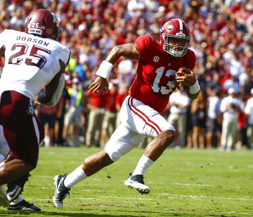 (AP Photo/Butch Dill, File). FILE - In this Sept. 22, 2018, file photo, Alabama quarterback Tua Tagovailoa (13) scrambles for a first down against Texas A&M during the first half of an NCAA college football game, in Tuscaloosa, Ala.  Tagovailoa is ...