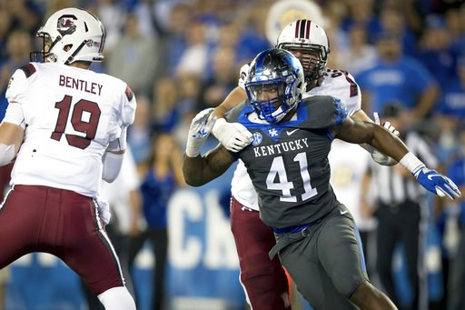 (AP Photo/Bryan Woolston, File). FILE - In this Sept. 29, 2018, file photo, Kentucky linebacker Josh Allen (41) rushes South Carolina quarterback Jake Bentley (19) during the second half of an NCAA college football game in Lexington, Ky. Allen is the d...