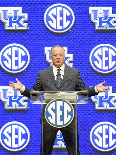 (AP Photo/John Amis, File). FILE - In this July 16, 2018, file photo, Kentucky head coach Mark Stoops speaks during NCAA college football Southeastern Conference media days at the College Football Hall of Fame in Atlanta. Stoops is the coach of the yea...