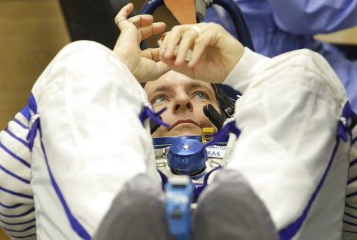 (AP Photo/Dmitri Lovetsky). CSA astronaut David Saint Jacques, member of the main crew of the expedition to the International Space Station (ISS),  during an inspection of his space suit prior to the launch of Soyuz MS-11 space ship at the Russian leas...