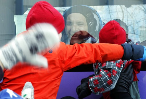 (AP Photo/Dmitri Lovetsky, Pool). CSA astronaut David Saint Jacques, member of the main crew to the International Space Station (ISS), interacts with his children from a bus prior to the launch of Soyuz-FG rocket at the Russian leased Baikonur cosmodro...