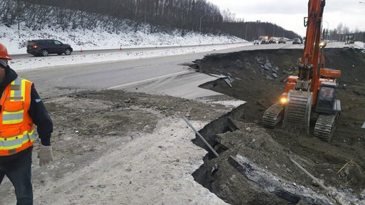 (Chris Riekena via AP). This photo provided by Chris Riekena shows excavation work being conducted Saturday, Dec. 1, 2018, near the Mirror Lake exit of the Glenn Highway near Eklutna, Alaska, to make the highway ready for repaving. The highway was heav...