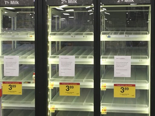 (AP Photo/Mark Thiessen). Empty milk refrigerators are shown at a grocery store in Anchorage, Alaska, on Sunday, Dec. 2, 2018, two days after a magnitude 7.0 earthquake was centered about 7 miles north of the city. Anchorage officials urged residents n...