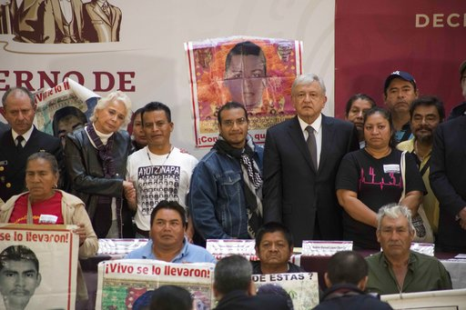 (AP Photo/Christian Palma). Mexico's President Andres Manuel Lopez Obrador poses for a photo with the parents of the 43 missing Mexican students of Ayotzinapa, at the National Palace in Mexico City, Monday, Dec. 3, 2018. Mexico's newly inaugurated pres...